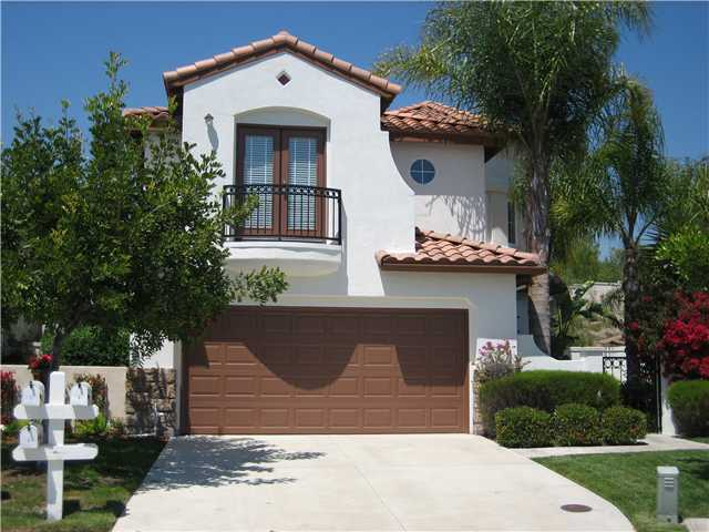 One And Two Story Homes Located In South Coto Monticeto Feature Spanish Style Exteriors